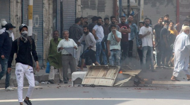 Spontaneous shutdown was observed at several places in Kashmir after clashes broke out between youths and security forces following rumours about scrapping of Article 35A, a police official said.