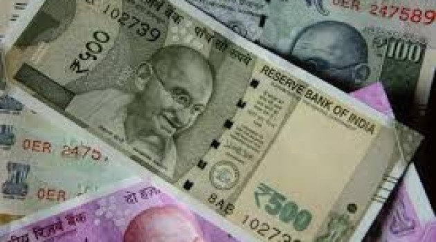Rupee gains by 8 paise against USD