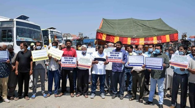 Transporters hold protest in demand of compensation