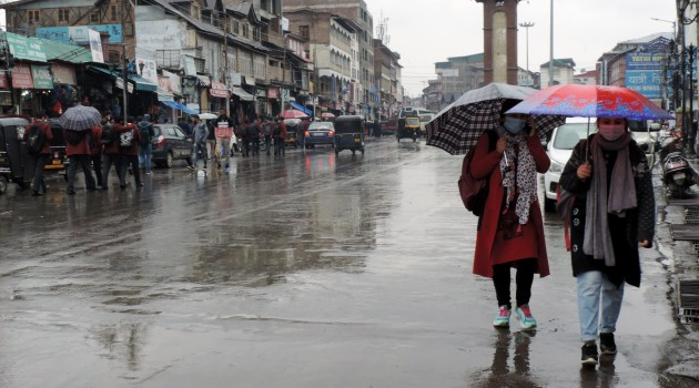 Umbrellas out as incessant rains lash Kashmir valley disrupting normal life on Monday