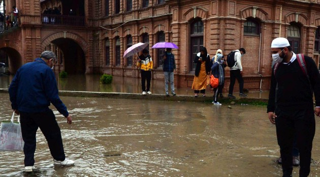 Water-logged Amar Singh College in Srinagar as incessant rains continued to lash Kashmir on the third day plunges the temperature and disrupt normal life on Wednesday
