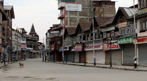 Security forces enforce strict lockdown in Srinagar to combat the surge in COVID-19 positive cses in Kashmir valley on Wednesday